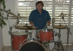 I'm still playing and I also build custom drums. And yes! That is my real hair!(no color added) I also still scuba dive